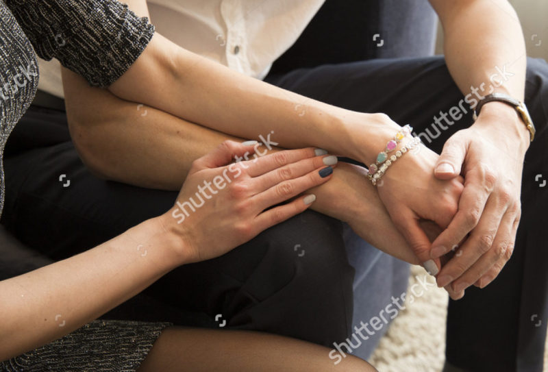 stock-photo-hands-of-lovers-437254396